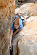 "Kate Dooley squeezing herself through two cruxes of ""Electra"" (19), one of Araps more famous heinous offwidths."