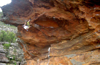 Malcolm Matheson (aka HB) climbing his new roof climb at Sentinel Cave.